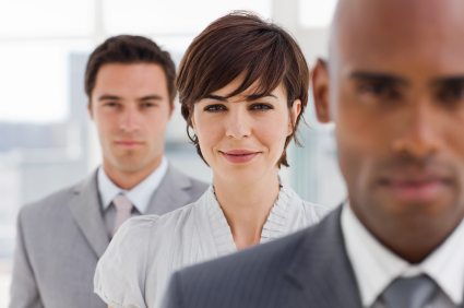 Businesspeople standing one after another